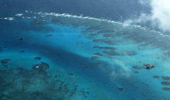 Tấm ảnh chụp đảo Gạc Ma này theo thông tin của Bộ Ngoại giao Philippines được chụp vào ngày 13 tháng 3 2012. Ở bên phải có thể nhìn thấy giàn bê tông mà Trung Quốc để lại sau một cuộc chiến đẫm máu năm 1998. Hình: DPA/ DFA