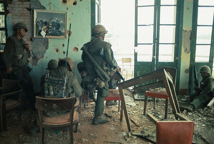 Vietcong attack. A group of US Marines keep an alert eye on activities outside building they are positioned in for refuge. February 05, 1968 Dana Stone
