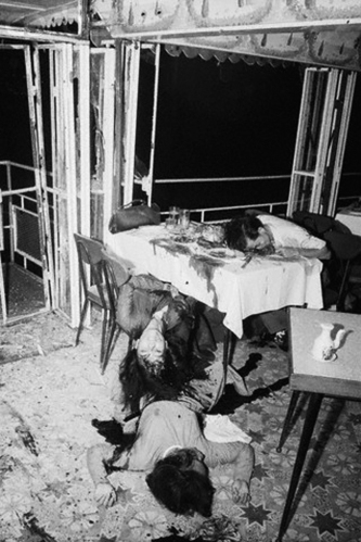 28 Jun 1965, Saigon, South Vietnam --- Saigon: A Floating Nightmare. Two young Vietnamese girls and their escort (right, at table) bear mute testimony to the violence of the Viet Cong bombs which destroyed the My Canh floating restaurant here June 25th. They were having supper when the terrorist blasts snuffed out 42 lives and wounded more than 80 persons in and near the boat-restaurant. --- Image by © Bettmann/CORBIS