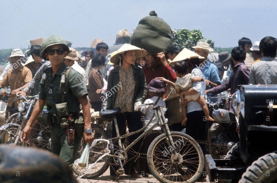 Vietnamese refugees fleeing on the road from Xuan Loc to Saigon as the communist North Vietnamese froces advance. April 1975. Photograph by Terry Fincher