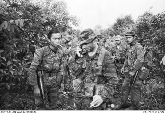 Một thành viên của Đội Huấn luyện Quân đội Úc tại Việt Nam, Đại úy Peter Shilston, xác nhận qua vô tuyến rằng ngôi làng mà ông vào sắp lùng sục với quân đội Nam Việt Nam đã được bao vây. Shilston là một trong sáu thành viên AATTV được trao tặng Huân chương Quân đội trong thời gian phục vụ tại Nam Việt Nam.